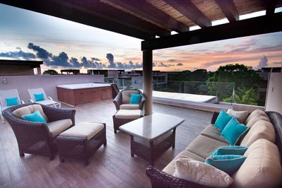 Relax on your Private 500 sq ft rooftop deck with outdoor living room & jacuzzi!