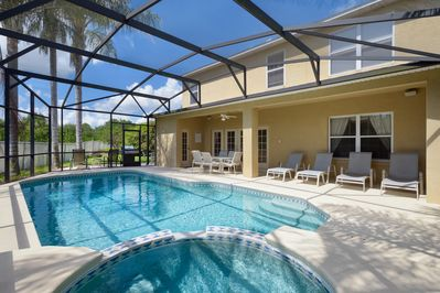 View from Pool to back of Villa and Side Yard, Sunning Deck, additional chairs