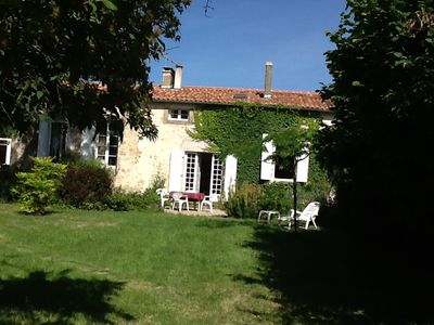 Photo for Charentais farmhouse furnished, well equipped, 5 bedrooms, large and beautiful garden
