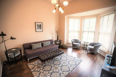 Stylish and comfortable living room with large bay window