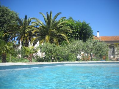 Photo for Apartment in a Provencal farmhouse with pool