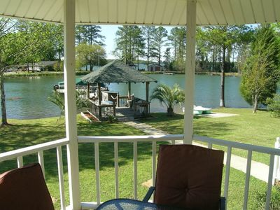 Photo for NEW LISTING! Spacious lakefront home with floating dock, gazebos, and game room!