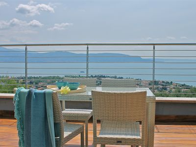 Photo for Modern style apartment limonaia, with magnificent views of the lake and a large swimming pool