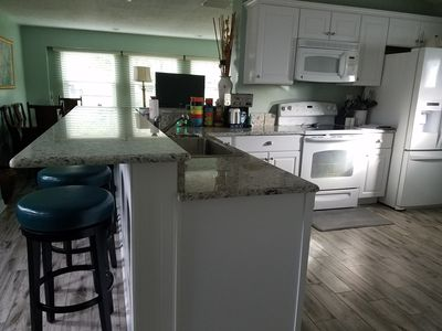 Photo for On the Pinellas Trail!  4 miles from the beach, 2 blocks from the golf course.