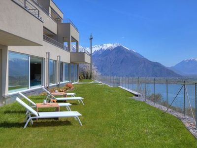 Photo for The elegant modern apartment in the wellness oasis of Lake Como Valarin Resort with a large panorami