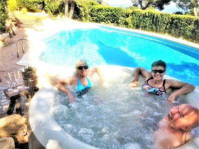 Hot tub and heated pool above the bay of S'ant Pol