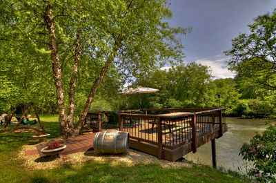 Large deck over the Toccoa river with seating to  enjoy the view and fish.