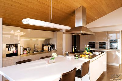Open plan kitchen with center island and large dining table