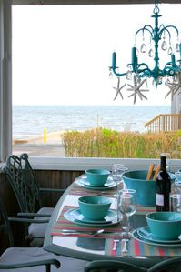 Outdoor dining with the beach just steps away.  And that chandelier!
