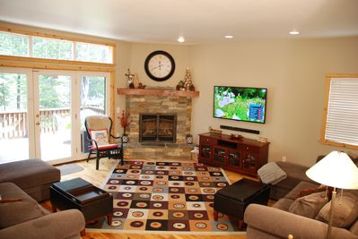 Sunken living room with gas fireplace, 55 inch Smart TV & two full size couches