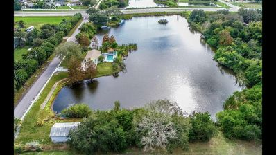 Photo for 2 bedroom 2 bath lake and pool home in the country setting of East Bradenton