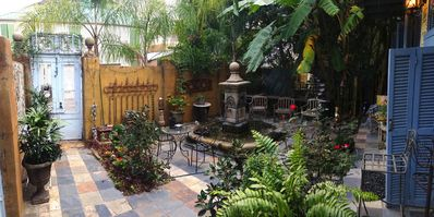 The centerpiece of the back garden is a French Provincial flowing fountain.