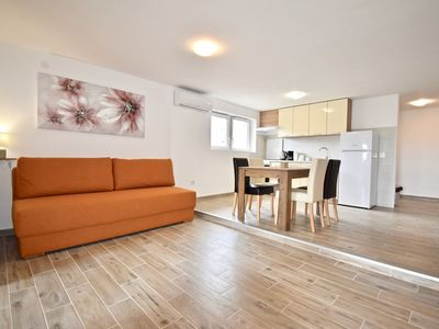 Photo for New apartment with lovely terrace and swing