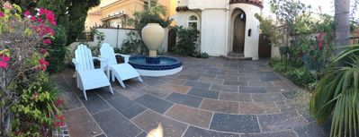 Beautifully landscaped courtyard with seating area