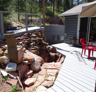 Deck off of master bedroom.  Waterfall on left.