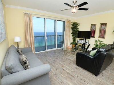 Photo for Lovely beachy condo w/ gulf view, shared pools & hot tub - walk to the beach!