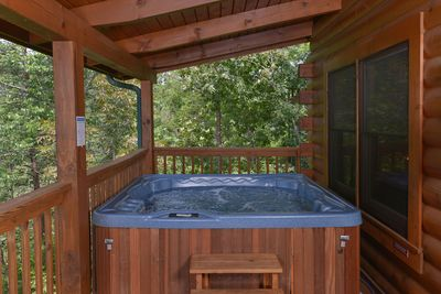 Soak in the hot tub as you enjoy the secluded wilderness surroundings.