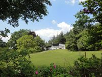 The house is located on top of a hill on the edge of a very small town, and offe ...