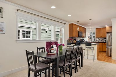 The dining area includes a large (expandable) dining table.