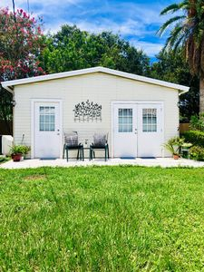 Photo for Come enjoy the Florida sun in your private poolside cottage near the beach