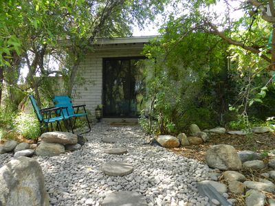 outside entrance , path to pool and patio