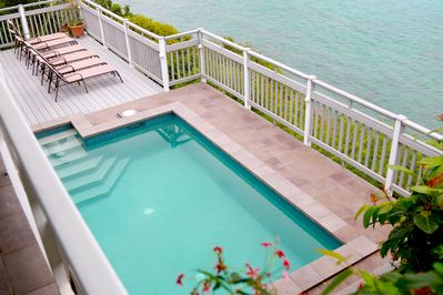 Pool view from upper deck and on the water!. You can count over 20 Islands!
