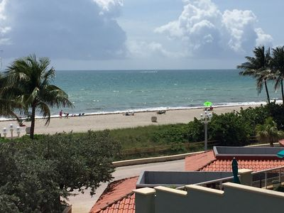 Photo for Beach Front, Full Kitchen, Renovated. Free WiFi, Cable TV, Gym. Pool,