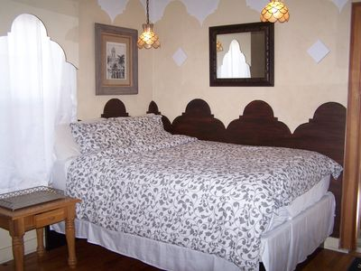 Queen-sized bed with comfy pillow-top mattress and 100% cotton linens.