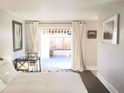 Studio, with queen bed, large french doors open to spacious private patio.
