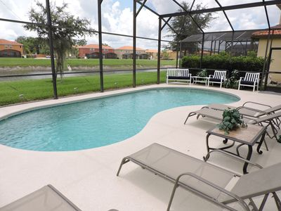 Photo for Completely remodelled 2019. Villa with own pool and lake view. Near Disney