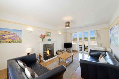 Living room open fire, looking over beach and sea