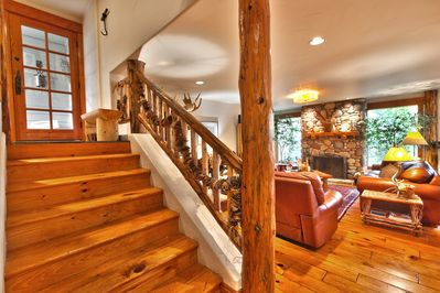 This condo is multi-level. Enter and go down the steps to the living room.