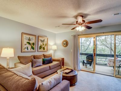 Photo for Welcoming condo w/ furnished deck, shared pools, & gym - close to the beach