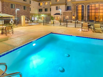 Photo for Heated Outdoor Pool + Hot Tub + Fitness Center Access | Centrally-Located Studio