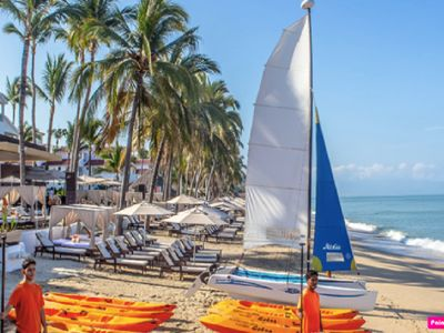 Photo for Beach Front, 5 Star!exclusive beach Club,Platinum Benefits 1,2,3 bed suites