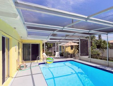 Relax and enjoy our specatcular heated pool and screened lanai - You'll love our private, heated pool with plenty of pool-side loungers so you can relax in the sun or shade.