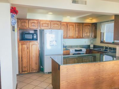 Kitchen-  Modern appliances, with beautiful Green marble granite counter tops.