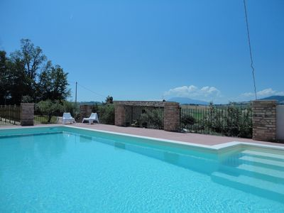 Photo for Farmhouse surrounded by green hills, between the land of vineyards and olive trees