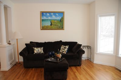 Enjoy a cocktail or glass of wine in our bright and cheery living room!
