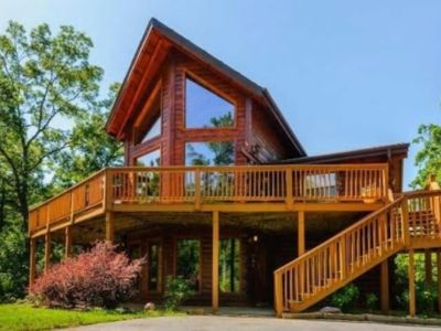 Photo for Custom log cabin with year-round views! HOT TUB &  Gameroom!