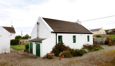 Photo for Traditional, petite charming Irish country cottage with beautiful sea views.