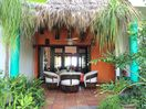 Front Palapa covered patio off pool.  You can see the beach through back doors