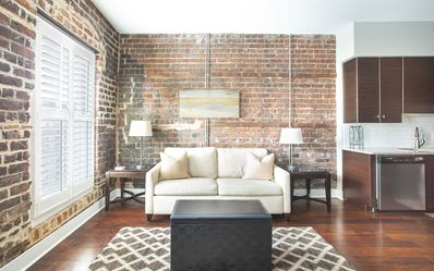 Original brick was left exposed for a modern feel.