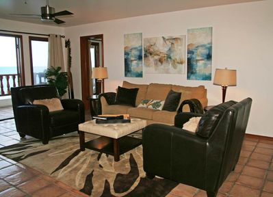 Living room with ocean views, fireplace, 60inch TV