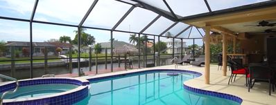 Photo for Beautiful 3 BR 3 BA on Canal 2 Min From Gulf Access, Lg Dock Heated Pool,Hot Tub