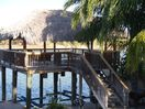 View from the screened porch to the Arroyo, palapa and boat lift