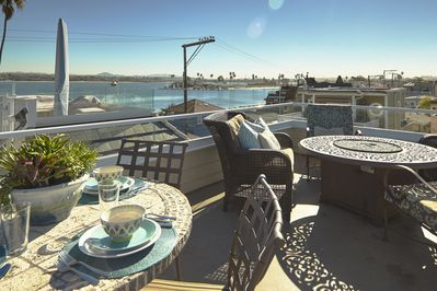 Fourth floor rooftop deck with seating, BBQ and and fire pit