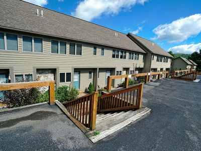 Lakefront town home #36 with a hot tub, 2 gas fireplaces, electric grill and community tennis!