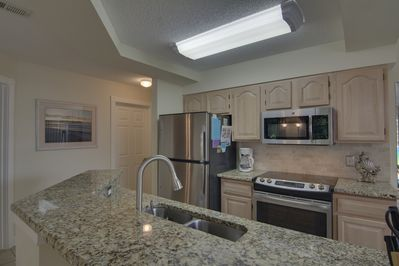 kitchen with granite & ss appliance