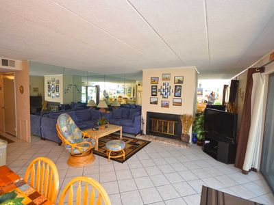 Photo for Cute, spacious 2 bedroom condo with WiFi and fun beach decor located midtown on the ocean block just steps from the beach!
